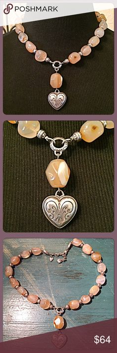 "30% OFF BUNDLESBrighton Agate Heart Necklace Gorgeous ""Y"" style beaded agate stones necklace with such a pretty heart to drape your neckline. Classic Brighton scroll etchings on the heart, rondels, & 'love' hardware. Silver plated, 14.5""L w/2.75"" extender, heart lobster claw clasp. Center drop is approx. 2.5"". Worn about 2-3x. In great condition. This is an older piece no longer available. Will come in a pretty jewelry pouch as I don't have the original tin heart it came in anymore. Brighton…"