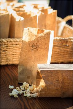 Monogrammed popcorn bags as end of the night wedding favors. Captured By: Erica Chan Photography http://www.weddingchicks.com/2014/06/20/handcrafted-barn-wedding-2/