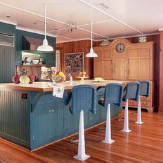 This kitchen's bar stools were purchased from an antique shop, and formerly used in an ice cream parlor. | Coastalliving.com