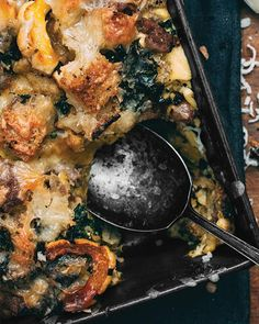 Savory Bread Pudding with Delicata Squash, Kale, & Sausage | Bread pudding is usually considered a dessert but it really shines as a main dish. Layers of sourdough, sausage, fall vegetables, and cheese soaked in rich custard bake together to make the perfect brunch dish or light dinner.  Sweet Paul Magazine