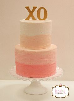 2 tier ombre buttercream wedding cake with hand painted gold fondant topper.  Coral ombre cake.  Coral and gold cake.  Cake: Frost It Cupcakery #XO