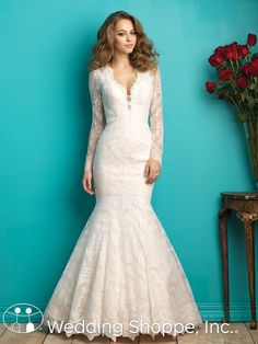 A stunning long sleeve lace gown with plunging neckline.