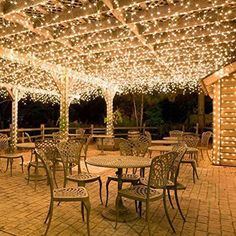 Put lights under the outside patio. Hang white icicle lights to create magical outdoor lighting. This idea works well for decks, patio lights and covered porches. Imagine these icicle lights at an outdoor wedding reception? Icicle Lights, Led Fairy Lights, String Lights Outdoor, Solar Lights, Outdoor Lighting, Outdoor Decor, Pergola Lighting, Light String, Indoor Outdoor