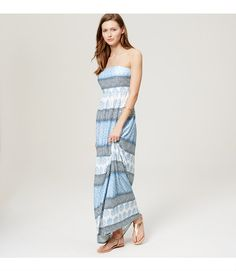 "In sunny stripes, this strapless maxi the easiest way to make a chic surf-to-shore side transformation. Elasticized neckline and waist. Shirred beneath waist. Partially lined. 41 1/2"" from natural waist.     Items in our Swim Collection can only be exchanged or returned by mail."