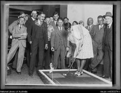 Newspapers held competitions with generous prizes- a big incentive when unemployment was high! Woman competitor about to hit a mini golf ball at the Sun Mini Golf Course, New South Wales, 6 January 1931 Putt Putt Golf, Dance Marathon, Miniature Golf, Calisthenics, South Wales, Golf Ball, Golf Courses, Competition, January