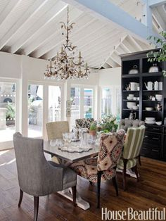 """The 2011 Kitchen of the Year with Tyler Florence - House Beautiful. Mismatched upholstery fabric sets an unfussy, informal mood in the dining area. """"The kitchen is designed to move from a small dinner party to a big huge holiday gathering,"""" Florence says.  Bernhardt table, Circa Lighting chandelier, Kravet chairs and fabric, Sherwin-Williams paint."""