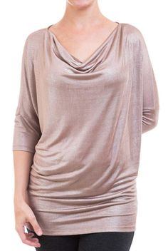 This simmering, mocha colored top features draping dolman sleeves and cowl neckline. Such a lovely top to dress up with. A fluid medium weight knit. Unlined. Opaque.