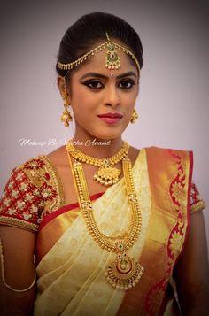 Vaishnavi looks like a vision in red, gold and white for her muhurtam. Makeup and hairstyle by Vejetha for Swank Studio. Red lips. Maang tikka. South Indian bride. Eye makeup. Bridal jewelry. Bridal hair. Silk sari. Bridal Saree Blouse Design. Indian Bridal Makeup. Indian Bride. Gold Jewellery. Statement Blouse. Tamil bride. Telugu bride. Kannada bride. Hindu bride. Malayalee bride. Find us at https://www.facebook.com/SwankStudioBangalore
