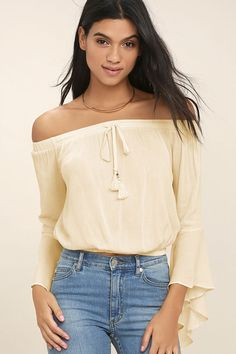 Escape to music-filled fields in the Festival Camp Cream Off-the-Shoulder Crop Top! Light and gauzy rayon falls from an elasticized, drawstring, off-the-shoulder neckline (with beaded tassels) to long bell sleeves. Cropped bodice has an elasticized hem.