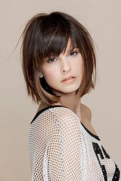 Messy layered chin-length bob with heavy bangs