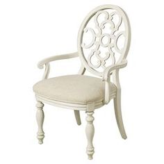 "Arm chair with an ornate open back and turned legs.     Product: ChairConstruction Material: Elm wood, birch wood and fabricColor: WhiteDimensions: 40"" H x 22"" W x 25"" D"