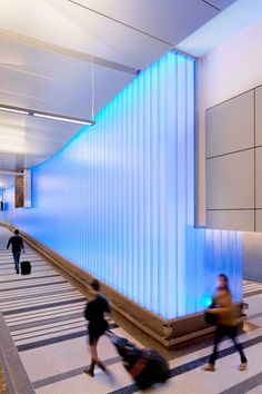 Tom Bradley International Terminal's overhaul at the Los Angeles Airport - walls along the arrivals and greeting centre were made of the profiled glass Pilkington Profilit™ successfully integrated with the lighting installed between glass panels.