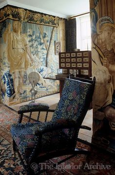 Tapestries line the walls of the study at Kelmscott Manor, once the home of Wiliam Morris