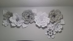 Paper flower wall decor in grey and white