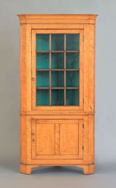 Pennsylvania Tiger Maple Two-Part Corner Cupboard, early 19th century, 90 h. x 43 W.
