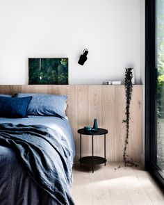 Home Decor Minimalist Built-in oak plank ledge takes the place of a traditional headboard in this minimal bedroom with blue bed linen and black metal furniture Blue Bedding, Blue Bedroom, Bedroom Sets, Bedroom Decor, Bedding Sets, Master Bedroom, Bedroom Furniture, Minimal Bedroom, Modern Bedroom