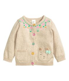 Fine-knit cardigan in cotton with colorful, fabric-covered buttons. Contrasting details.