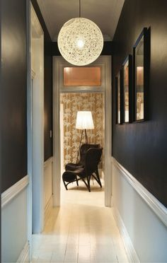 """SMALL ROOM - Hallways go light or go home? """"It's really about how you want the hallway to feel. Do you like a sense of mystery? Paint it dark. Do you like drama? Give it color as opposed to using a neutral,"""" says Krane"""