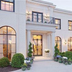 Elegant exterior. Black mullions and doors add great contrast. Renaissance Development Corporation