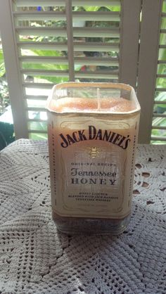 Jack Daniels Tennessee Honey Jack Daniels Candle bottle Glass recycled upcycled bottle Man cave bar decor. $39.99, via Etsy.