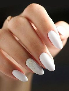 Much like a great nude shade, white nail polish seamlessly goes with every outfit, is perfect for any occasion, and complements all skin tones. White nail polish suits all skin tones and looks gorgeous in the summer! White And Silver Nails, White Almond Nails, White Glitter Nails, White Acrylic Nails With Glitter, White Acrylics, Basic Nails, Simple Nails, White Nail Designs, Acrylic Nail Designs