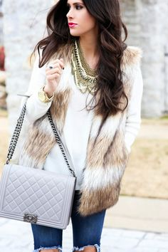 faux fur vest, chic wish fur vest, ripped jeans, knee ripped jeans, grey chanel boy bag, the courtey bibb, bauble bar courtney bib with pearls, emily gemma, cream v neck sweater, michael hors runway watch in gold