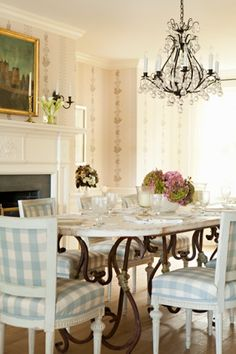 Long Island Waterfront Cottage ~ Pretty dining room, pale blue and white accents, crystal chandelier, wrought iron table