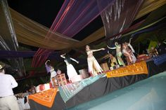 Belly dancers on custom stage built over swimming pool #moroccanparty http://www.collection26.com/events/services/private-events/