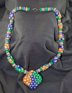 Statement green orange and purple necklace by workshopwhims