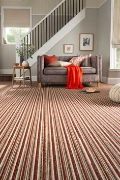 Brighten a grey and cream room with blasts of colour like red and orange use pattern and hints of plain to make an impact. Add textured accessories to make the room cosy. hillarys.co.uk