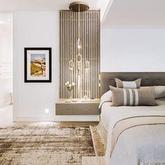 Subtle textural contrasts define the master bedroom.