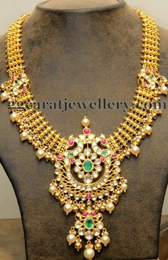 Jewellery Designs: Gold Classy Haram with Trendy Locket