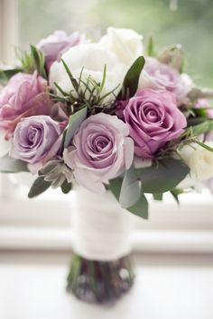 A beautiful bridal bouquet ~ consists of Pacific Blue, Avalanche, Cool Water & Ocean Song roses with white hydrangeas, herbs & eucalyptus