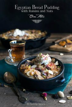 Om Ali is the ultimate bread pudding. With origins from the middle east, this version bursting with raisins, dried apricots, pistachios, cardamon and more! -- FamilySpice.com