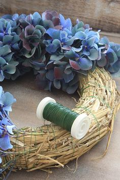 hydrangea garden care hydrangea wreath-- this is going to dry immediately. I cant find instructions, but I am assuming that the intention is to create a dried wreath. dried hydrangea is hard to work with, so this is actually not a bad idea Wreath Crafts, Diy Wreath, Door Wreaths, Hydrangea Garden, Hydrangea Wreath, Deco Floral, Wreath Tutorial, Garden Care, Summer Wreath