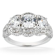 Vintage Heirloom Diamond Ring 14K White Gold - This very popular vintage style ring features a .50ct center & two .33ct sides. All diamonds are set in solid 14k white gold with a 1.75ct total diamond weight. #unusualengagementrings