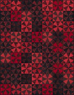 FREE PATTERN - Tonga Rising Sun - Red Dawn Dimensions: 56.5″ x 72.5″ Quilt by Osie Lebowitz