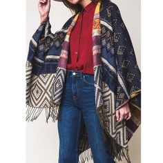 "XX The KARA print tassel poncho - NAVY Multi pattern tassel poncho. Exceptional quality.,dimensions 61"" x 55"". 100% acrylic. AVAILABLE IN GREY & NAVYNO TRADE, PRICE FIRM Sweaters Shrugs & Ponchos"