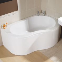 Short on space? Invest in a corner bath we say.