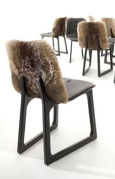 Tiller chairs: Vue de Monde custom - charactered timber chairs and upholstered with kangaroo pelts and hide.