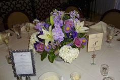 Photo of  a table with the menu along with the centerpiece and table number
