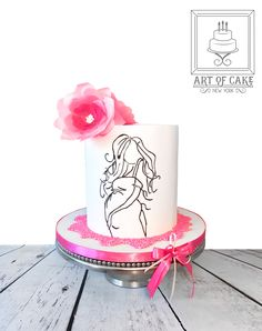Original design by Lori's Custom Cakes It's a girl! Baby shower double barrel chocolate raspberry cake covered in white chocolate with edible wafer paper flowers