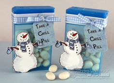 So cute - Any snowman stamp would do + a container of Tic Tac's + ribbon. Do it in red + white and give the snowman a heart for valentines day candy gift at school.