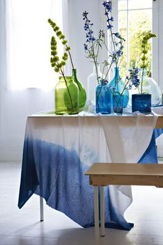 Group colored glass water bottles for a greater impact Blue (R45), Woolworths and blue bottle left (R39, 99), Mr Price Home. Other colored glaspotte (from R195 - R675), Loft Living. Bench (R1 050) and 1.8 m table (R4 400), Pedersen & Lennard