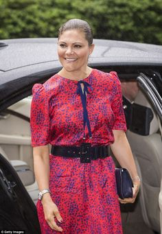 All smiles: A chipper looking Crown Princess Victoria of Sweden makes a splash in a colour...