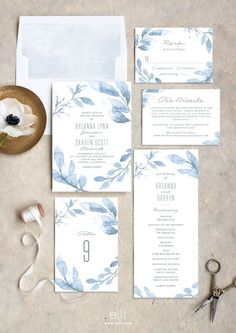 Gorgeous dusty blue wedding invitation suite with blue painted leaves. | Wedding invitations | Wedding stationery | #wedding #weddinginvitations #invitations #savethedate | www.starlettadesigns.com