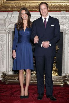 A well-known look: Kate in a navy Issa dress announcing her engagement at St. James Palace.