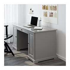 IKEA - LIATORP, Desk, gray, , You can fit a computer in the cabinet since the shelf is adjustable.Drawer stops prevent the drawers from being pulled out too far.Can be placed anywhere in the room because the back is finished.