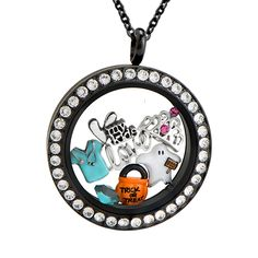"""There's a child in all of us who is still a Trick-or-Treater at heart! Get all dressed up this Halloween but always remember to be you! Our Black Twist Living Locket Base + Face with Swarovski® Crystals is filled with a few of our favorite """"costumes!"""""""