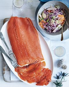 Nathan Outlaw cures salmon with brandy in this Christmas-appropriate recipe. Serve with the seasonal slaw for some welcomed crunch – together it's the perfect dinner party main. Veg Dishes, Salmon Dishes, Fish Dishes, Vegetable Dishes, Slaw Recipes, Salmon Recipes, Seafood Recipes, Healthy Recipes, Healthy Meals